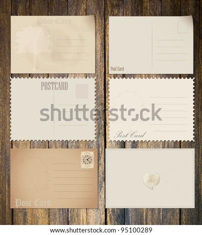 Vintage postcard  on wood - stock photo