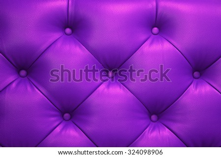 Vintage purple leather Sofa Button for textured background - stock photo