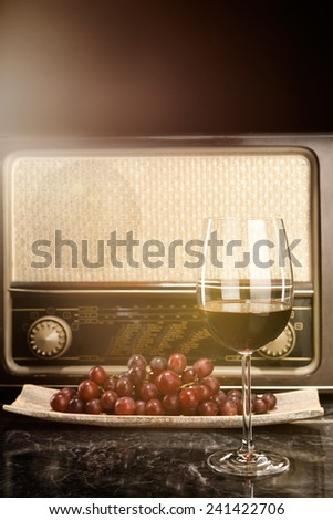 Vintage Radio, grapes and a glass of red wine - stock photo