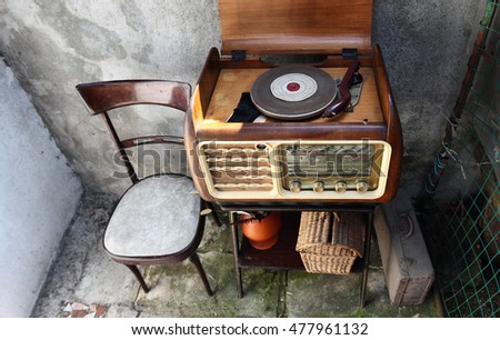 Vintage Radio Receiver cabinet  in a shabby  home interior