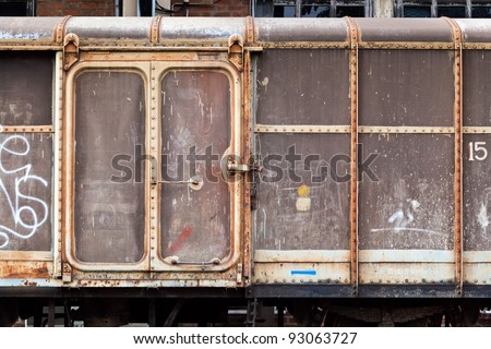 Vintage railroad container doors with more rusty old and pale color. - stock photo