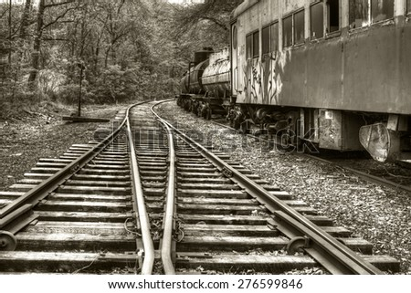 Vintage railroad tracks and abandoned train
