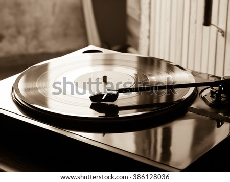 Vintage record player with vinyl disc, close-up. - stock photo