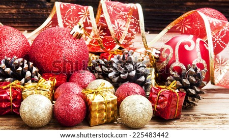 Vintage Red and Golden Christmas Decoration with Glitter Globes,Little Gifts and Cones - stock photo