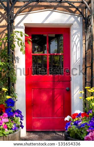 Vintage red door at the entrance to an adobe building in Santa Fe, NM, USA - stock photo