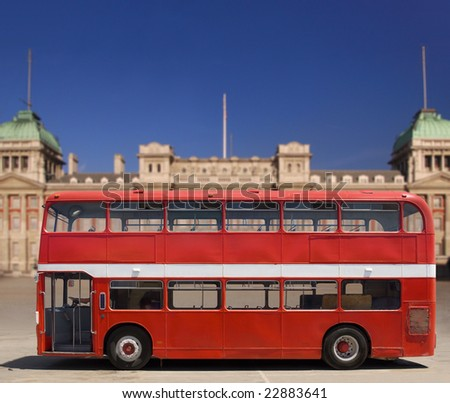 Vintage, red double decker British bus in front of Buckingham Palace, isolated with clipping path - stock photo