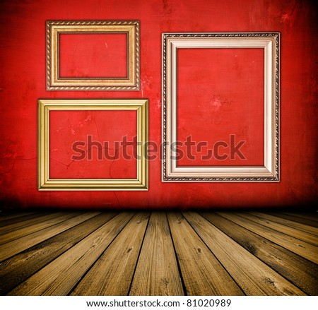 vintage red interior with empty frame hanging on the wall - stock photo