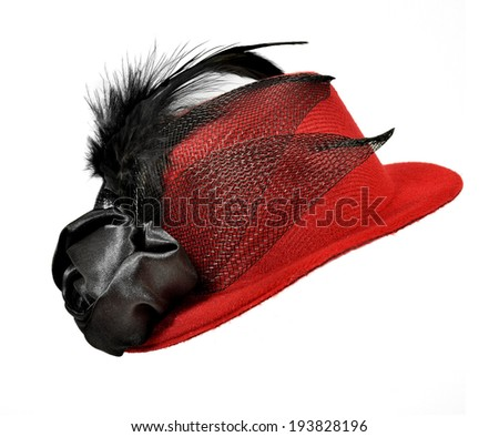 Vintage red  lady's hat with  black feathers and textiles isolated on white - a carnival costume accessory. - stock photo