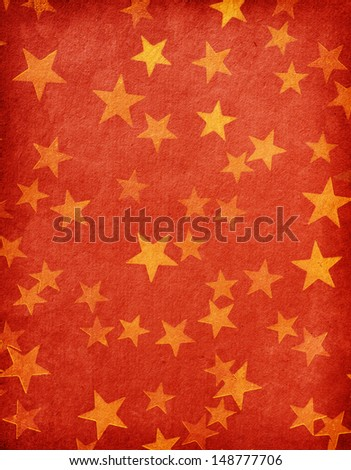 vintage red paper decorated with  gold stars - stock photo