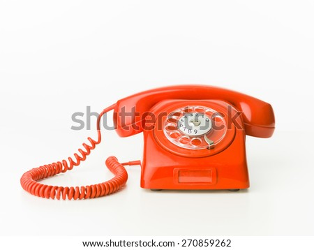 vintage red phone isolated on white background. copy space available - stock photo