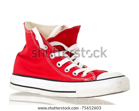 Vintage red shoe side view on pure white background - stock photo