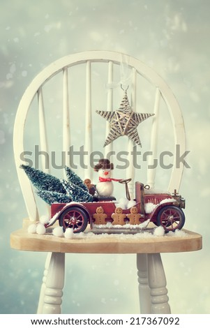Vintage red truck snow scene with gingerbread men and snowman - stock photo