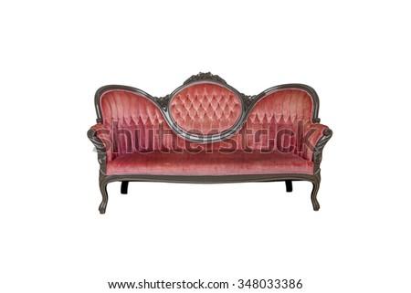 Vintage red velvet sofa isolated on white - stock photo