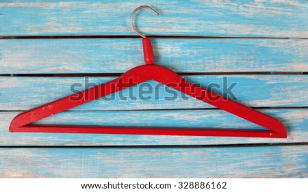 Vintage red wooden hanger  on rustic wooden background  - stock photo