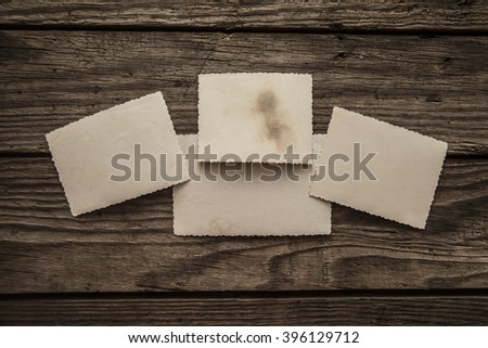 Vintage retro aged empty photo paper on wood texture  background - stock photo