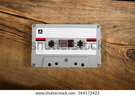 vintage retro audio tape on wood background - stock photo