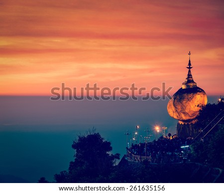 Vintage retro effect filtered hipster style image of Golden Rock - Kyaiktiyo Pagoda - famous Myanmar landmark, Buddhist pilgrimage site and tourist attraction, Myanmar - stock photo