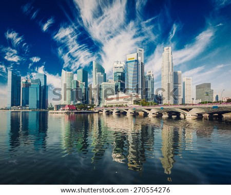Vintage retro effect filtered hipster style image of Singapore business district skyscrapers skyline and Marina Bay in day - stock photo