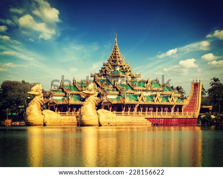 Vintage retro effect filtered hipster style image of Yangon icon landmark and tourist attraction:  Karaweik - replica of a Burmese royal barge at Kandawgyi Lake, Yangon, Myanmar (Burma) - stock photo