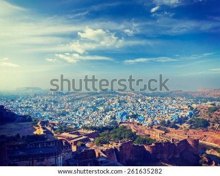 """Vintage retro effect filtered hipster style panorama image of Jodhpur, also known as """"Blue City"""" due to the vivid blue-painted Brahmin houses. View from Mehrangarh Fort.  Jodphur, Rajasthan, India - stock photo"""