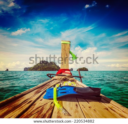 Vintage retro effect filtered hipster style travel image of snorkeling set on boat, sea, island. Thailand - stock photo