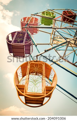 Vintage retro ferris wheel on blue sky - stock photo