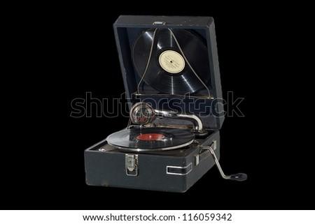 Vintage retro gramophone isolated on black - stock photo