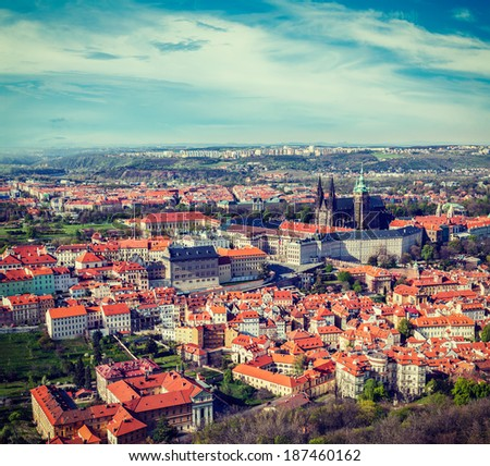 Vintage retro hipster style travel image of aerial view of Hradchany part of Prague: the Saint Vitus Cathedral and Prague Castle, view from Petrin Observation Tower. Prague, Czech Republic - stock photo