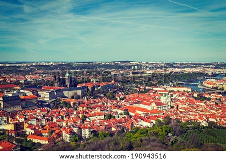 Vintage retro hipster style travel image of aerial view of Hradchany part of Prague: the Saint Vitus (St. Vitt's) Cathedral and Prague Castle view from Petrin Observation Tower. Prague, Czech Republic - stock photo