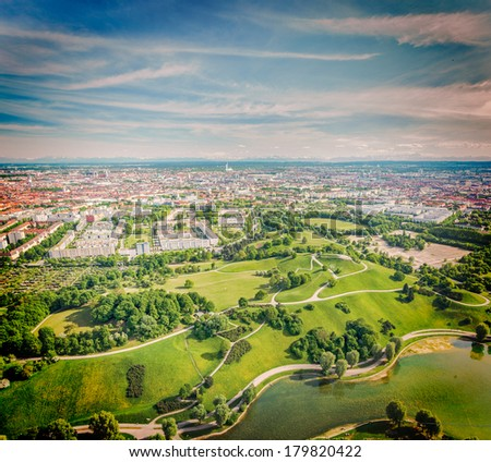 Vintage retro hipster style travel image of aerial view of Olympiapark and Munich from Olympiaturm (Olympic Tower). Munich, Bavaria, Germany - stock photo