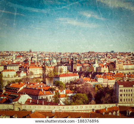 Vintage retro hipster style travel image of aerial view of Prague from Prague Castle. Prague, Czech Republic with grunge texture overlaid - stock photo