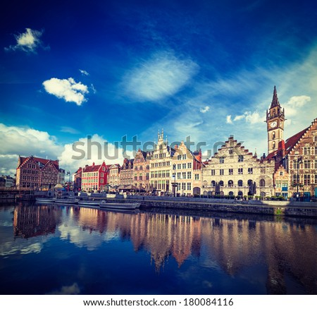 Vintage retro hipster style travel image of Europe Belgium medieval town travel background - Ghent canal and Graslei street on sunset. Ghent, Belgium - stock photo