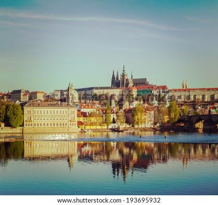 Vintage retro hipster style travel image of Mala Strana and  Prague castle over Vltava river. Prague, Czech Republic - stock photo