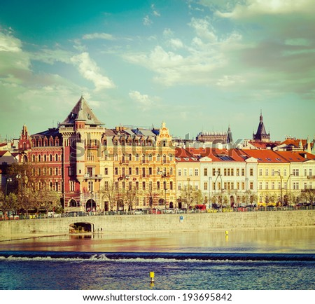 Vintage retro hipster style travel image of Prague Stare Mesto embankment view from Charles bridge on sunset. Prague, Czech Republic - stock photo