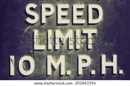 Vintage retro looking A traffic sign speed limit 10 mph - stock photo