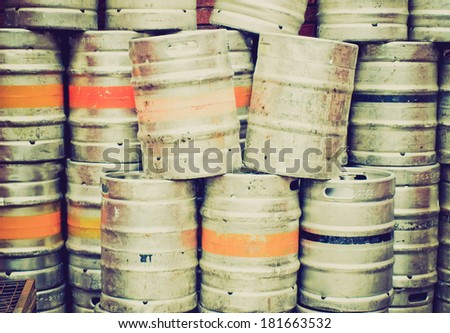 Vintage retro looking Range of stacked beer casks of kegs - stock photo