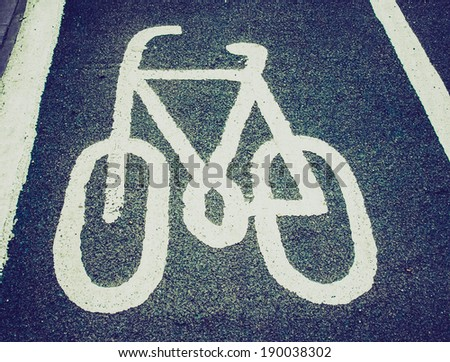 Vintage retro looking Sign of a bike or bicycle lane - stock photo