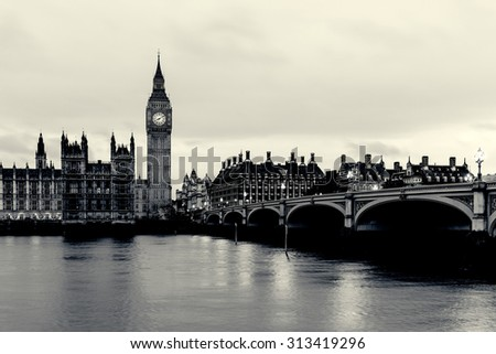 VINTAGE/RETRO PHOTO FILTER EFFECT: Elizabeth Tower, Big Ben, Houses of Westminster and Westminster Bridge from the South Bank of the River Thames at Dusk, London, England UK - stock photo