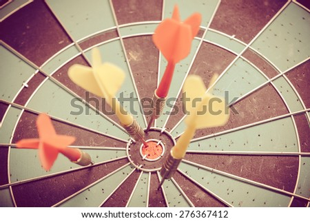 Vintage retro picture style - Dart is an opportunity and Dartboard is the target and goal. So both of that represent a challenge.  - stock photo