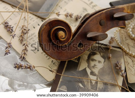 Vintage romance with old violin - stock photo