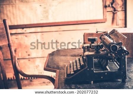 Vintage Room and Aged Wooden Desk with Typewriter.  - stock photo
