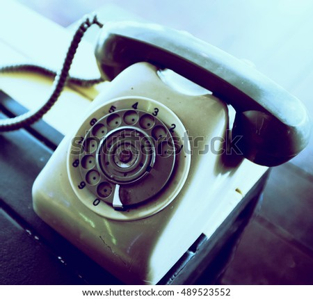 vintage rotary telephone on wood table background