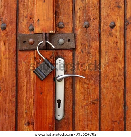 Vintage Rustic Grunge Brown Red Wooden Double Door Or Gate With Opened Padlock Background Texture