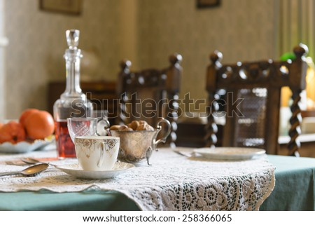Vintage 1940s interior English table setting with teacup nuts wine and oranges on & Vintage 1940s Interior English Table Setting Stock Photo (Royalty ...