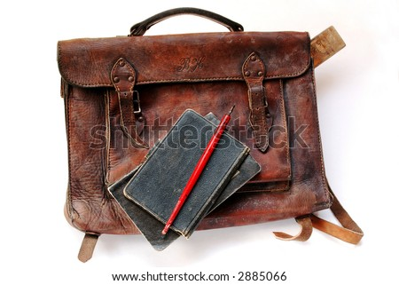 Vintage schoolbag with notes and pen - stock photo