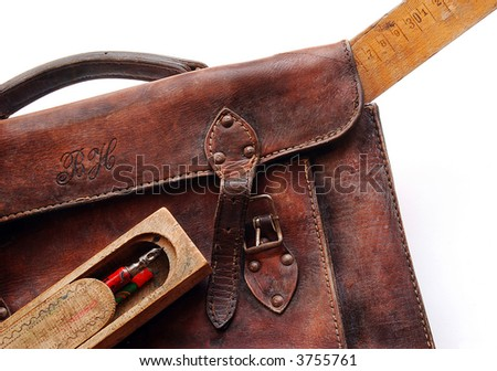 Vintage schoolbag with ruler and pen-case, detail, isolated - stock photo