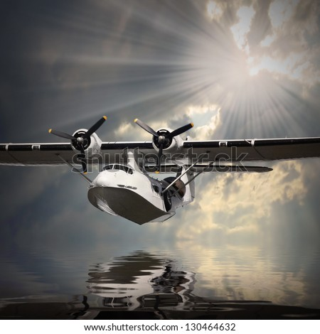 Vintage seaplane over sea. - stock photo