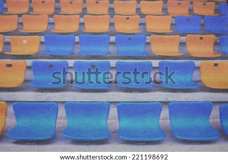 vintage seat rows in stadium paper picture - stock photo