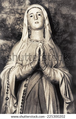 Vintage sepia image of Holy Virgin Mary Catholic Church Mother of God religious woman praying  - stock photo