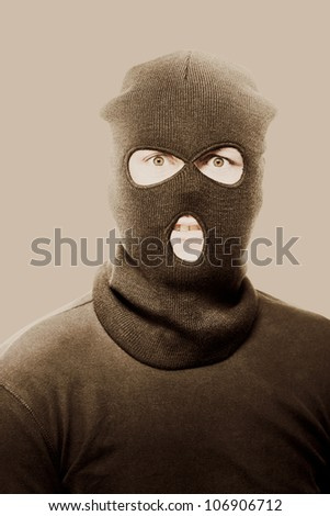 Vintage sepia toned portrait of a radical fanatical terrorist staring with a threatening look of intent to commit acts of violence and terror - stock photo